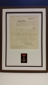 OBE certificate and medal